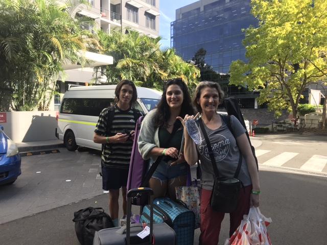 family outside hotel