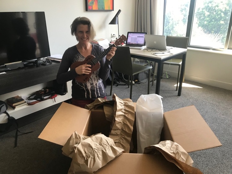 woman unpacking ukulele